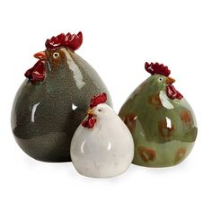 With round, plump bodies and simplified characteristics this set of three ceramic stylized chickens in shades of green, red and white are sure to look great in any setting!