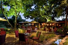Beautiful photo of an outdoor restaurant, café or bar/tavern at night with landscape or nightscape / mood lighting in full effect.  Culinary Houston: Las Ventanas Restaurant and Cantina.