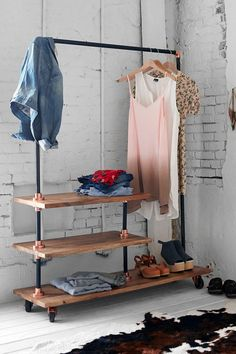 A Fantastic way to store hanging clothes in a small closet-less room. Read More on VintageandKind.com