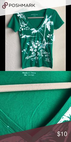 56457656a37 Shop Women s Margaritaville Green White size S Tees - Short Sleeve at a  discounted price at Poshmark. Description  Green tropical V neck Tee.