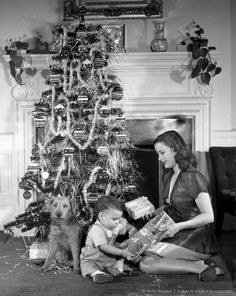 1950s mother and child opening christmas gifts wow good pic of familial normalness - Vintage Christmas Photos