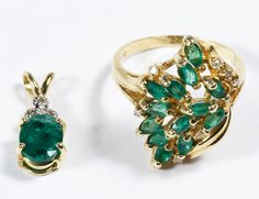 Lot 195: 14k Gold, Emerald and Diamond Jewelry; Two pieces including a ring having thirteen marquis cut emeralds highlighted by diamond chips and marked 14k inside band and a pendant having an oval cut emerald topped by three diamond chips