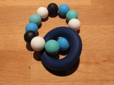 Silicone Teething Ring A beautiful colourful teether that your baby will love! The ring and beads are made from food grade Teething, Food Grade, Beads, Rings, How To Make, Etsy, Beautiful, Beading, Ring