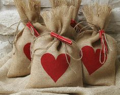 Be unique this Christmas with these reusable Gift Bags!  They would be great for small gifts, treat bags or for favor bags at your Christmas party.  You will receive a set of Four burlap gift bags with a hand painted white Christmas tree. (Christmas tree is only painted on one side)  Four jute twine ties will be included with your purchase.  Four rustic brown jingle bells are included for gift tie ons.  Each bag may vary in size, but they measure approximately 7 x 11.  Seams have been…