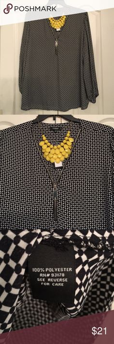 Reserved for msterryv Black and white geometric print blouse. Long sleeves with elastic at the wrist. Close up of zipper neckline and print shown in picture 2. Fabric content shown in picture 3. Back shown in picture 4. Premise Tops Blouses