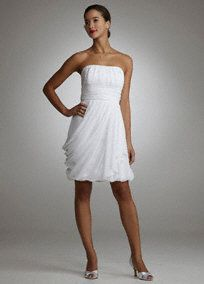 Softand flowing, this draped chiffon bubble dress is simple yet elegant!   Strapless bodice features shirring detail for added texture and dimension.  Slimming ruched waist band flatters any figure.  Side-draped chiffon skirt is feminine and romantic.  Bubble hem adds a modern touch.  Fully lined. Invisible back zipper. Imported polyester. Dry clean only.  Available in White. To protect your dress, try our Non Woven Garment Bag.