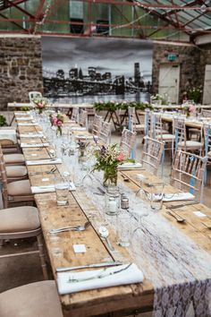 Rustic Reception with Lace Table Runner & Wild Flower Centrepieces - Cassandra Lane Photography | Plas Dinam Country House Venue in Wales | Bright Country Flowers | David's Bridal Wedding Dress | BHLDN Bridesmaid Dresses