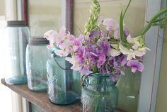 I love jars!    It doesn't matter how I'm using them...    soap dispenser    drinking glass    flower vase    hanging lantern    or resting on my little window shelf www.postroadvintage.com/2010/07/its-window-chalkboard-pic...    I love them all the same!