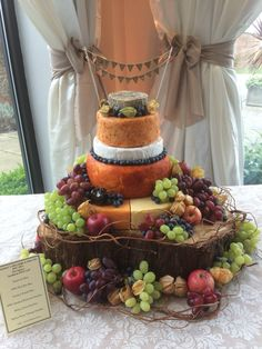 A rustic, fruit filled five tiered cheese wedding cake. Made up of Belton Farm Red Fox, Belton Farm Vintage Cheddar, Redwood Smoked Cheddar, Creamy French Brie, Red Hot Mex and Nantwich Blue.