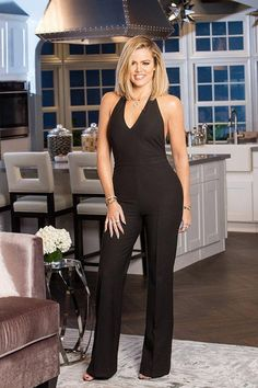 Khloe Kardashian wearing Sarah Chloe x Monica Rose Marina Personalized Lariat Necklace, Elizabeth and James Britta Halter Jumpsuit and Cartier Aldo Cipullo Gold Love Necklace