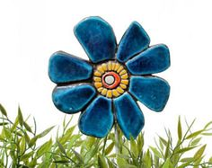 Flower garden art made from ceramic.    Our ceramic plant stakes are fantastic small garden ideas, they also make great gifts. These garden markers add a unique touch to any house and garden and look great in a plant pot or flower bed. Our ceramic garden art is handmade and hand painted making each one truly unique. Our garden art is mounted on a stainless steel rod and made using the highest quality earthenware and is frost resistant. These garden markers can also be used as grave markers…