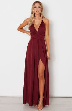 Love the dark red color of this maxi and the slit! Not loving the plunge of the neckline tho.