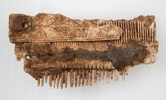 Double-Sided Comb Date: 7th century Geography: Made in Niederbreisig, Germany Culture: Frankish Medium: Bone, iron pins Dimensions: Overall: 4 1/16 x 2 1/16 x 9/16 in. (10.3 x 5.2 x 1.5 cm)