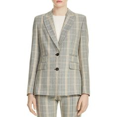 --evaChic--This Maje Valila Shoulder Pad Plaid Jacket is a sharp menswear-inspired statement piece featuring notched lapels, a flap back vent, and a chic check motif. The single-breasted style is further accented close to the waistline with jet and flap pockets. Contrast buttons are a smart detail.     https://www.evachic.com/product/maje-valila-shoulder-pad-plaid-jacket/