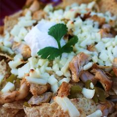 "Chicken Nachos | ""Super-simple but totally killer nachos! These are to die for with some guacamole, sour cream and salsa. If it's too spicy for you, just leave out the cayenne."""