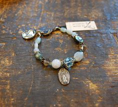 Our Lady of Guadalupe medal on an 'Alluring Aqua' bracelet from Artistic Works by Lu jewelry.