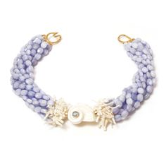Helga Wagner Lavender colored Jade with White Fresh Water Pearls, White Turbo Shell with Blue Topaz cabochon set in 14k Gold and Tiffany clasp, 18 inches. Attracting attention, this Blue Jade Helga Wagner design is a statement that exudes exquisite natural beauty. http://www.helgawagner.com/shop/n508-22-lavender-colored-jade-with-white-branch-coral-white-turbo-shell-with-blue-topaz-cabochon-and-tiffany-clasp
