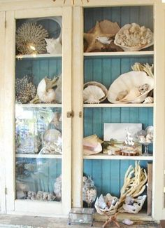 Beach Cottage Vintage Cabinet to display Ocean treasures.I like the blue painted on the back of the cabinet Beach Cottage Vintage Cabinet to display Ocean treasures.I like the blue painted on the back of the cabinet Beach Cottage Style, Beach Cottage Decor, Coastal Cottage, Coastal Homes, Coastal Style, Coastal Living, Cottage Ideas, Coastal Bedrooms, Beach Homes