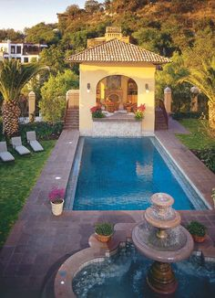 Casa Cariño pool house.  The pool is 20 feet by 40 feet and 13 feet deep. The fountain is also a hot tub.