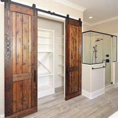 We kinda have a thing for naturalwood finishes and this custom Cedar bi-parting door in this master bathroom by @myartisanhome is no exception!