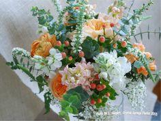 stock, garden roses, hypericum berries, spiral eucalyptus, baby's breath, veronica