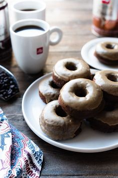 The only thing better than coffee and doughnuts is Coffee-Glazed Baked Chocolate Doughnuts! This easy baked doughnut recipe is made with dark chocolate and rich bold coffee perfect for coffee lovers! Made with illy coffee Baked Doughnut Recipes, Baked Doughnuts, Homade Donuts, Powdered Donuts, Donuts Donuts, Donut Muffins, Mini Desserts, Baking Recipes, Dessert Recipes