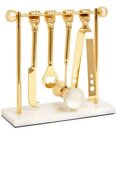"""40 Chic Wedding Gifts to Buy Off-Registry: Stop stressing about finding the perfect wedding gift—we've got you covered. Jonathan Adler """"Barbell"""" barware set, $198, neimanmarcus.com."""