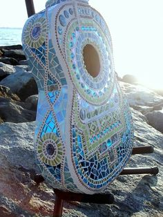 An artist who takes a very different approach to turning musical instruments into art is American artist Lisa Calabro of Crooked Moon Studio in Warwick, Rhode Island. Lisa has transformed old instruments into artworks by mosaicing them. Blue Mosaic, Mosaic Art, Mosaic Glass, Stained Glass, Guitar Art, Cool Guitar, Violin, Blue Guitar, Ukulele Art