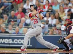 St. Louis Cardinals' David Freese (23) hits a sacrifice fly, bringing in teammate Allen Craig, during the fourth inning of the National League wild card playoff baseball game against the Atlanta Braves, Friday, Oct. 5, 2012, in Atlanta.
