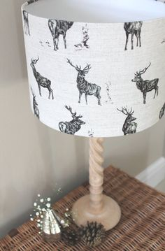 A beautiful lamp shade in this Stag cotton/linen fabric, designed and printed in the UK.  Every lamp shade is carefully hand made by Rachel Bonas in County Durham.  These lamp shades are handmade to order in a range of sizes, as shown below: Sizes available: 20 cm diameter x 18 cm high or 20cm (oval) length x 13.5cm width x 15cm high 30 cm diameter x 21 cm high or 30cm (oval) length x 22.5cm width x 20cm high 40 cm diameter x 25 cm high  Lamp shades are suitable for ceiling pendants or…