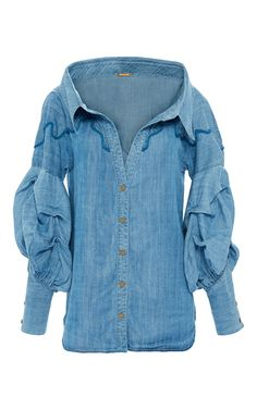 This **Johanna Ortiz** shirt features a button up style and a portrait neckline.