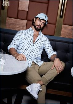 Embracing polka dots, Walter Savage dons a LE 31 oxford shirt with joggers and a Calvin Klein logo cap.