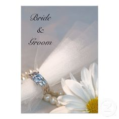 #Daisy Elegance #Wedding #Invitation  Invite your friends and family to your upcoming nuptials with the pretty Daisy Elegance Wedding Invitation. This classy custom botanical wedding invite features a digitally enhanced floral photograph of a white daisy flower blossom, diamond wedding ring set and white pearl necklace. Perfect for the couple who are planning a classy white flowery or daisy wedding theme. http://www.zazzle.com/loraseverson*