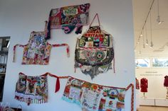 Some of Bonny Gorsuch's Fabric Assemblage Aprons, this month, Cannon Beach Gallery.  $79 each.
