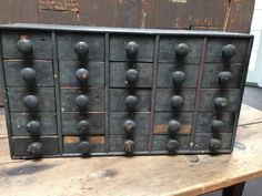 22in long x 12in tall x 6in deep.Early Antique Apothecary Drawers Dry Dark Green/Black Paint