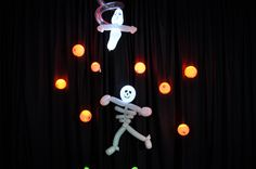 Our Super Spooky Ghost and Skeleton with eyeballs twisted by the talented TwistedMr, Matt Russell with lighting by Party Dots.