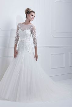 Brides.com: Wedding Dresses with Long Sleeves from the Bridal Runways. Embroidered long-sleeved gown, Ellis Bridals  See more bateau neck wedding dresses.