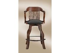 Incredible spectator style bar stool with leather seating, webbed seating for maximum comfort. Description: Distressed walnut finish. Leather seating. Nail head design. Traditional styling. Elongated metal footrest for added comfort.