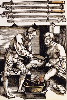 """medicine treatment cauterization woodcut coloured from """"""""Feldtbuch der Wundartzney"""""""" by Hans von Gersdorff Strasbourg Germany 1528"""
