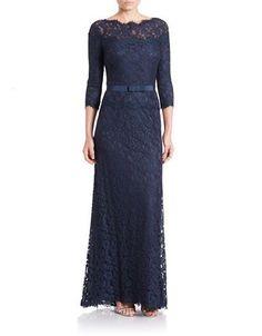 "<ul> <li>An elegant, belted design with an overlay of floral lace</li> <li>Bateau neck</li> <li>Three-quarter-length sleeves</li> <li>Concealed back zipper</li> <li>Sheer front and back yoke</li> <li>Belted waist</li> <li>Lined</li> <li>About 61"" from shoulders to hem</li> <li>Cotton/rayon/nylon</li> <li>Dry clean</li> <li>Imported</li> </ul><li>This item will arrive with a tag attached and instructions for removal. Once tag is removed, this item cannot be returned.</li></ul>"