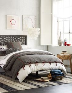In love with this modern bedroom design. Absolutely love the headboard, the light fixture and the bedding! #modern