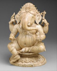 Seated Ganesha, made in India, 14-15th century (source).