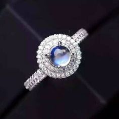 US Size 7 Charming 5mm Blue Moonstone Cocktail Ring with Sparkle Cubic Zirconias Halo  http://www.jewelsin.com/p-charming-5mm-blue-moonstone-cocktail-ring-with-sparkle-cubic-zirconias-halo-1253