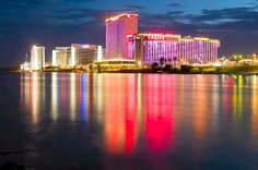 Lights from the Laughlin Casino reflect off the Colorado River at sunset in Laughlin, Nevada.  Laughlin, an unincorporated town of 7,300, is...