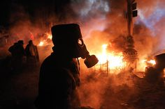 An anti-government protester wears a gas mask at the barricadesPhotograph: Reuters