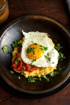 NYT Cooking: Anson Mills pencil cob grits make a great stand-in here for the… Eggs Over Medium, Thing 1, Corn Tortillas, Brunch, Stuffed Peppers, Grits And Eggs, Corn Grits, Cheese Grits, Fresh