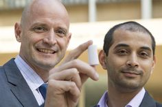 J.R. DeShazo, left, director of the UCLA Luskin Center for Innovation, and Gaurav Sant, associate professor in civil and environmental engineering, hold a a sample of the new building materials they have created to replace concrete.