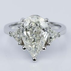 This recently purchased Three-Stone Trillion Engagement Ring features a 3.11 Carat Pear Diamond Center!