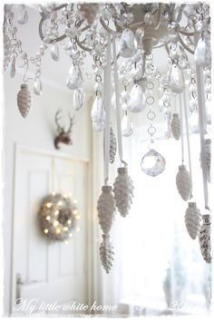 Nadine's Cakes & My little white home doing the ribbon and ornaments this year over table chandelier