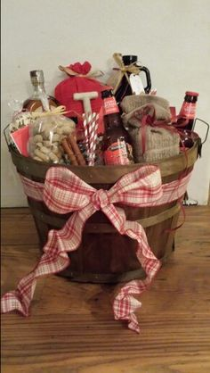 Apple Cider Fireball themed basket. Home pressed Apple cider, Fireball Whiskey, Hard Apple cider, cinnamon apple chip bread, homemade cinnamon butter, Apple butter, peanuts, cinnamon sticks, cinnamon spice tea, mugs, all in Ann old fashioned Apple basket